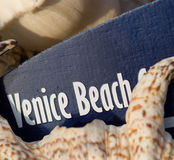 Venice Beach surfboard sign on shell beach Stock Photo