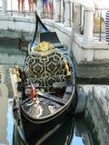 Venice black gondola. Amazing gondola in Venice, Italy with black and golden hues Royalty Free Stock Image