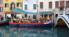 Venice boat. Street life. everything is on boat in Venice, the vegetables shop too royalty free stock photography