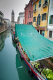 Venice boat market. Vegetable market in a canal in Venice - Italy Royalty Free Stock Photo