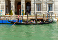 Venice. The boat trip tourists in gondolas. Royalty Free Stock Images