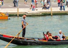 Venice. The boat trip tourists in gondolas. Royalty Free Stock Image