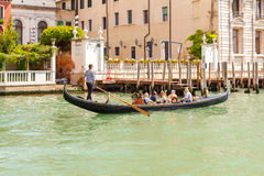 Venice. The boat trip tourists in gondolas. Royalty Free Stock Photography