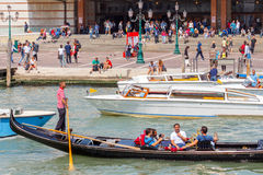 Venice. The boat trip tourists in gondolas. Royalty Free Stock Photos