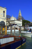 Boats waiting for tourists,Venice. Crowded Venice promenade and boats waiting for hire in the lagoon,Italy Stock Photos