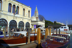Venice boats waiting for hire. Crowded Venice waterfront and motorboats in the wharf waiting for tourists,Italy Royalty Free Stock Images