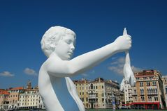 Venice, the boy with a frog Stock Photography