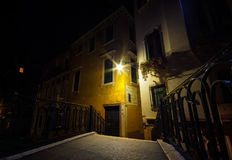 Venice bridge over canal at night and traditional architecture royalty free stock images