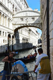 Venice, Bridge of Sighs, Ponte dei sospiri, with Venetian workers close up and gondolas Venice Royalty Free Stock Photos