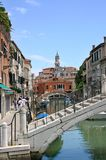 Venice Bridges. Bridges with church tower over the roof tops in Venice Royalty Free Stock Image