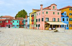 Venice burano color square. The town is known for its typical brightly colored houses and the centuries-old craftsmanship of Burano lace. Noteworthy are the Royalty Free Stock Image