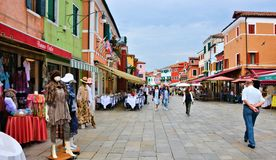 Venice burano color square. The town is known for its typical brightly colored houses and the centuries-old craftsmanship of Burano lace. Noteworthy are the Stock Photo
