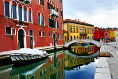 Venice, Burano island, boats on canal and colorful houses Royalty Free Stock Photo