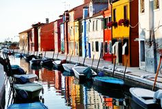 Venice, Burano island, boats on canal and colorful houses, Italy Royalty Free Stock Photo
