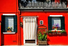 Venice, Burano island, painted red house, Italy Stock Photo