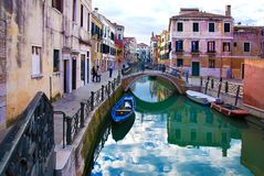 Venice, Burano island small canal and bridge Stock Photos