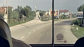 Venice bus tour. Venice, Italy - circa June 1967: tourist bus with guide woman on the road to Venice town. Highway and bridge crossing of Via della Liberta to stock footage