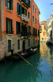 Venice. Canal. Vertical oriented image on gondola passing on small canal among old historic houses in Venice, Italy Royalty Free Stock Image
