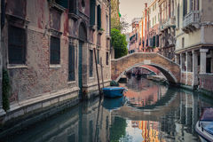 Venice canal. With gondolas and buildings Stock Photo