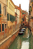 Venice canal. Small canal in the centre of Venice with boats and old brick buildings royalty free stock image