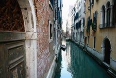 Venice canal. Boats on narrow canal in Venice city, Veneto, Italy Royalty Free Stock Photos
