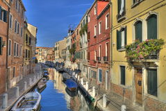 Venice Canal. A typical canal in Venice with beautifully colored houses Royalty Free Stock Photo