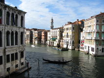 Venice Canal. A Venetian gondola boats on the grand canal in Venice, Italy Stock Image