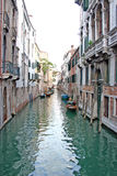 Venice canal. Scenic view of canal with boats moored by waterfront houses, Venice city, Veneto, Italy Stock Photography