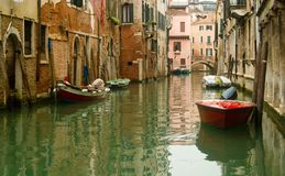 Venice canal. Venice architecture and boats on small canal royalty free stock images