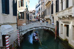 Venice Canal with beautiful bridge and typical venetian construction, houses colored, Venice, Italy summer 2016 Royalty Free Stock Photography