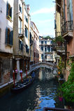 Venice Canal with beautiful bridge and typical venetian construction, houses colored, Venice, Italy summer 2016 Royalty Free Stock Images