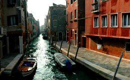 Venice canal and boats. Venice canal with moored boats between old buildings Royalty Free Stock Photography