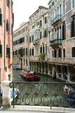 Venice, canal with boats stock images