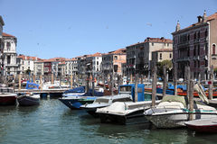 Venice canal with boats Stock Image