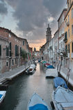 Venice canal with boats Stock Images