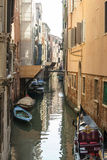 Venice canal with boats Stock Photos