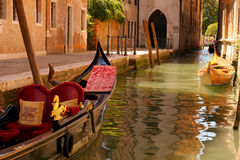 Venice Canal boats. Boats on a canal in Venice, sunny morning Stock Photo