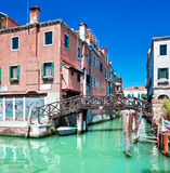 Venice canal with bridge and houses in water Stock Image