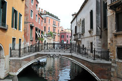 Venice canal and bridge Stock Images