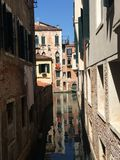 Venice canal with building reflection in the water royalty free stock photos