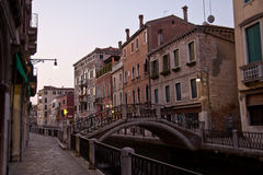 Venice canal. Colorful picture of canal and bridge and buildings during the sunrise in Venice, Italy Royalty Free Stock Photography
