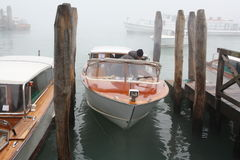 Venice canal in fog Stock Photo
