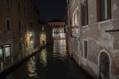 Venice canal at night with palace royalty free stock photos