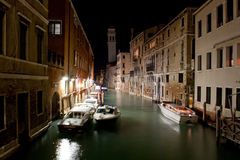 Boats in Venice Canal at Night royalty free stock photos