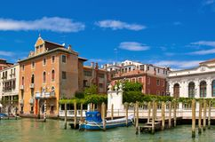 Venice canal with old buildings and piers Royalty Free Stock Image