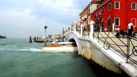 Venice - Canal Series. A boat goes under the bridge off one of the big canals in Venice Stock Image