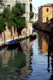 Venice - Canal Series. Backstreet canal with a rippled water reflection Royalty Free Stock Image