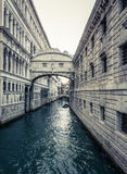 Venice Canal In Spring. Quiet Venetian Canal With Bridges and Boat Royalty Free Stock Photography