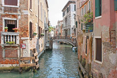 Venice Canal in summer with Gondola Royalty Free Stock Images