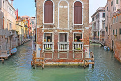 Venice Canal in summer with Gondola Stock Photo